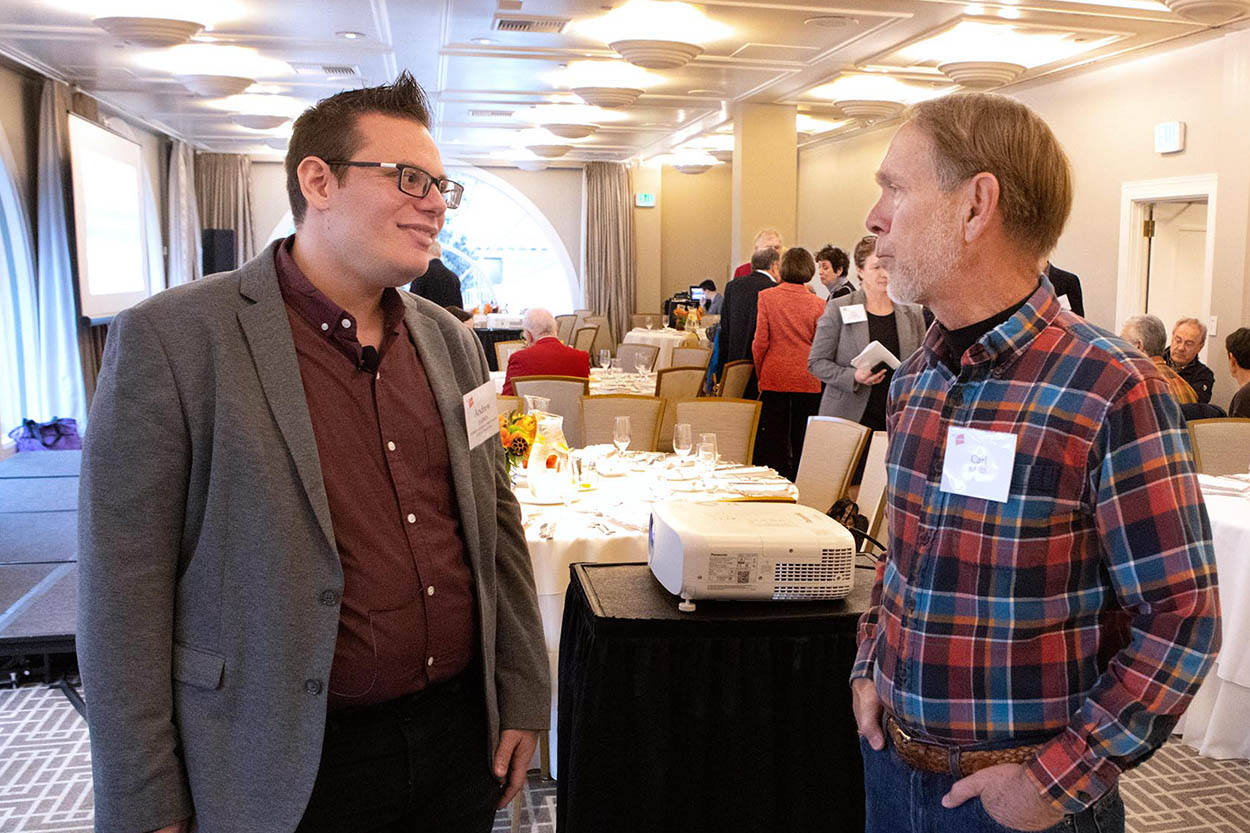 main speaker chatting with a guest before the seminar