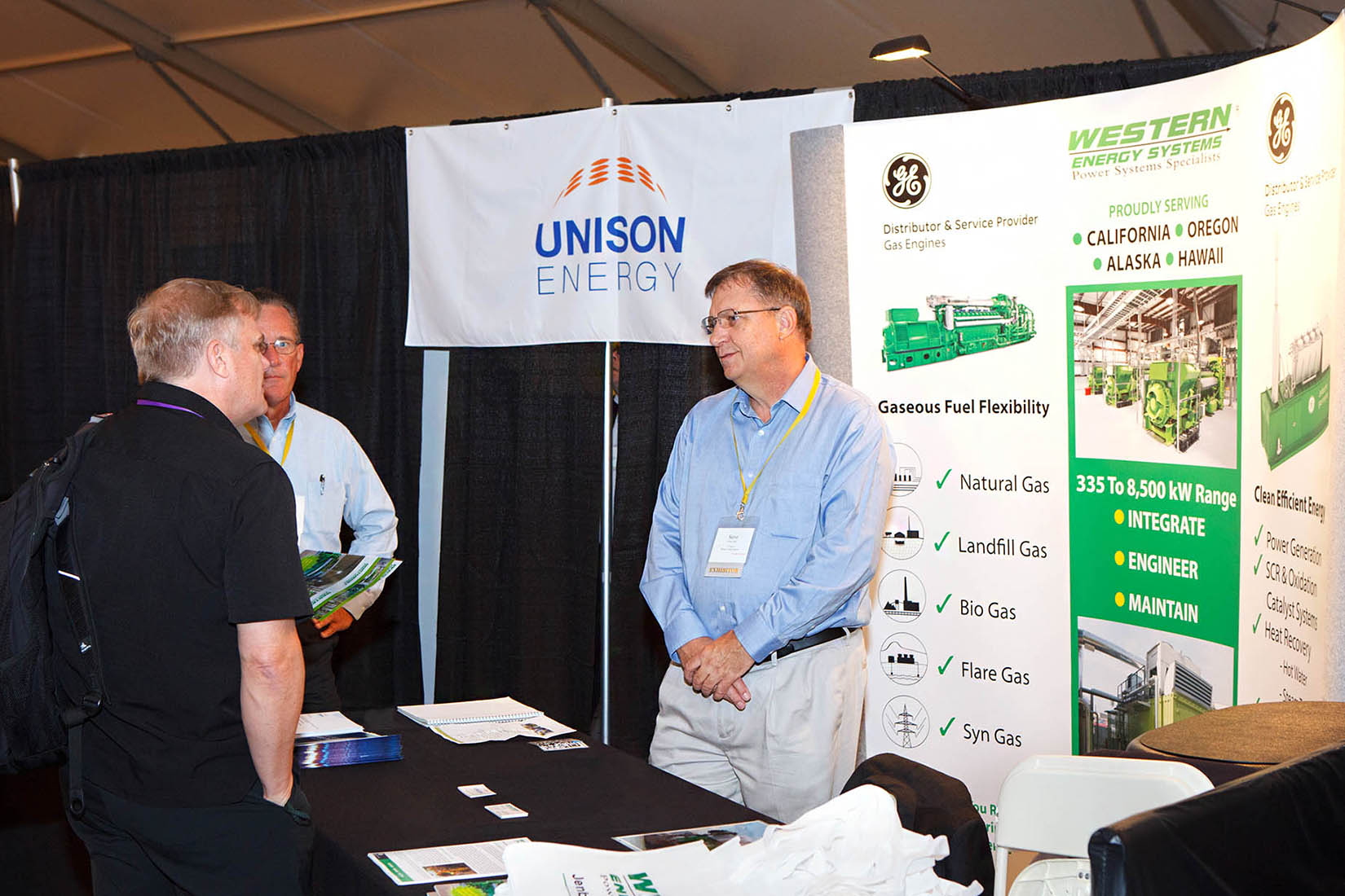 vendors speaking to a seminar attendee