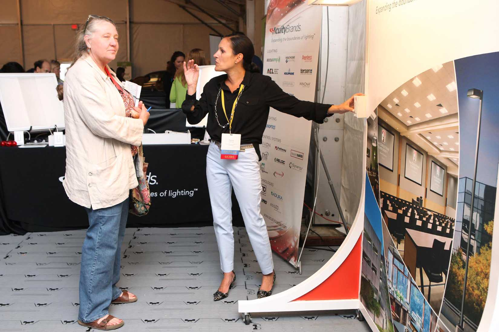 vendor explains to an attendee