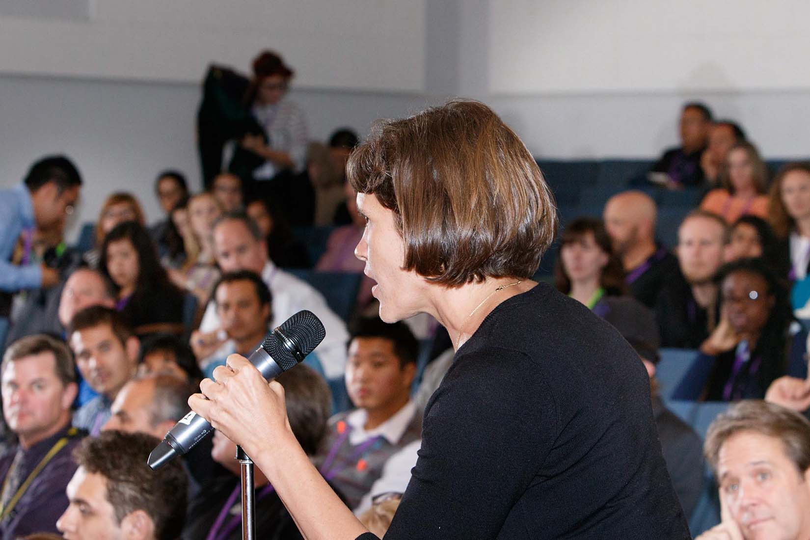 woman asking question during the chesc conference in sf