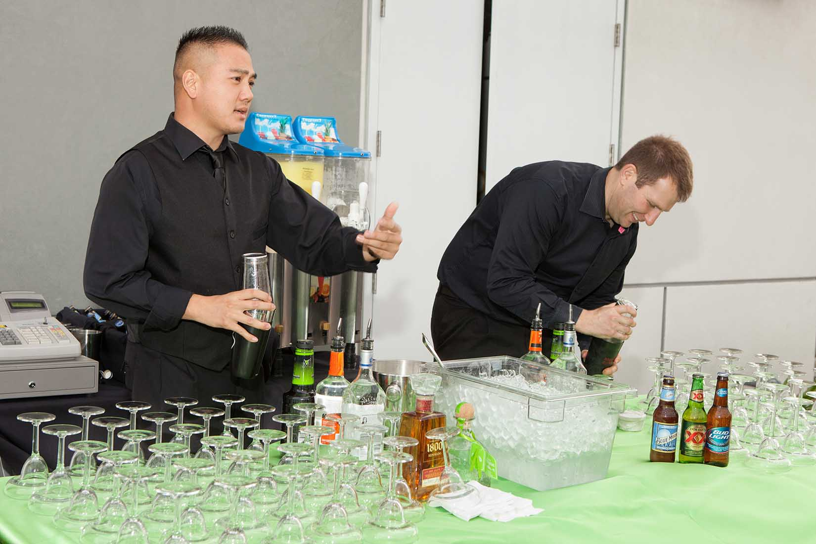 bartenders preparing drinks for the guests