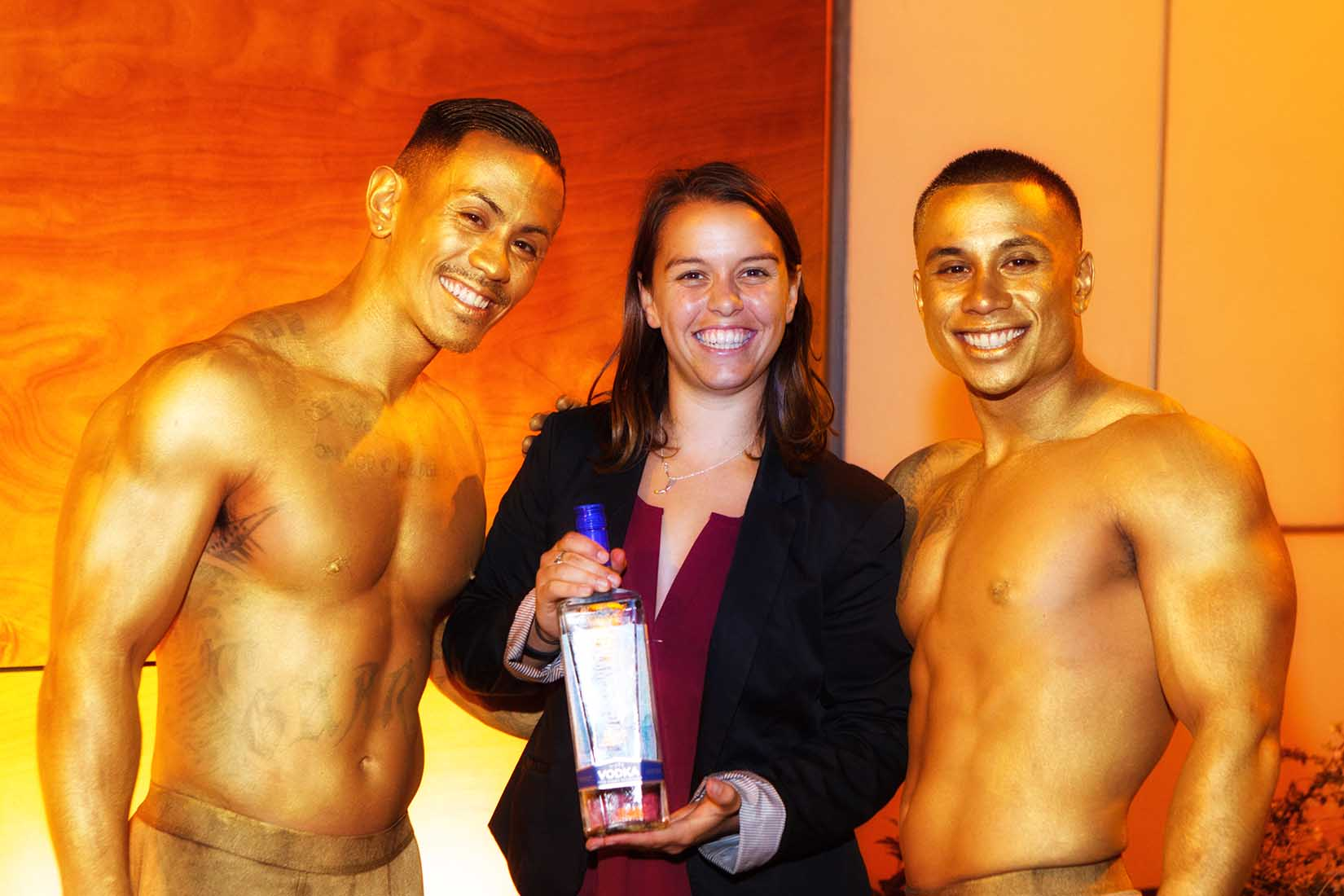 a female bartender posing with models