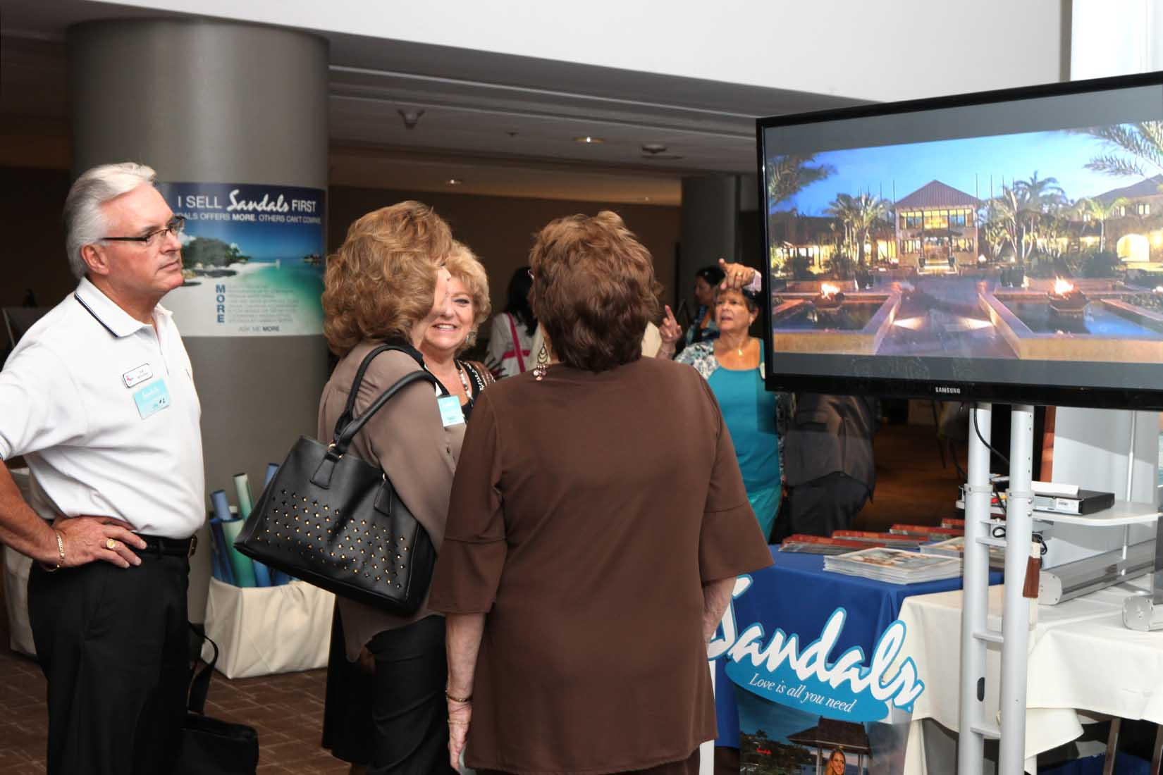 travel agent watching a promotional video