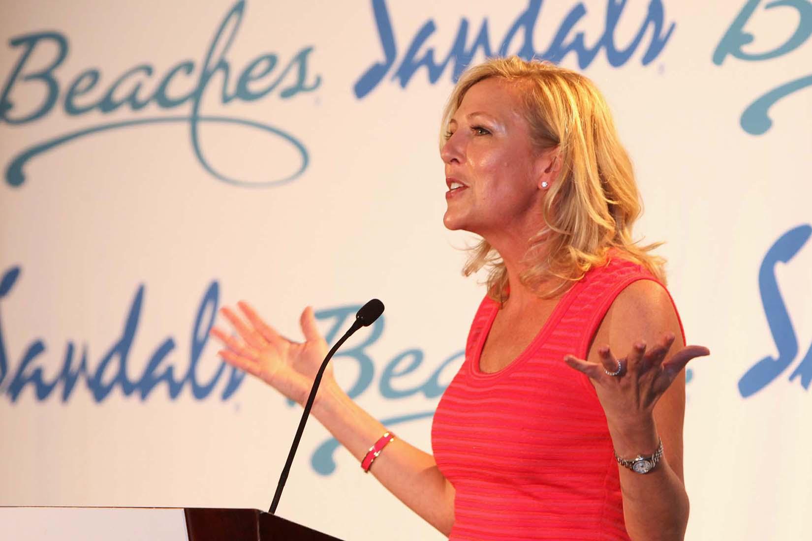 sandal female speaker addressing the attendees